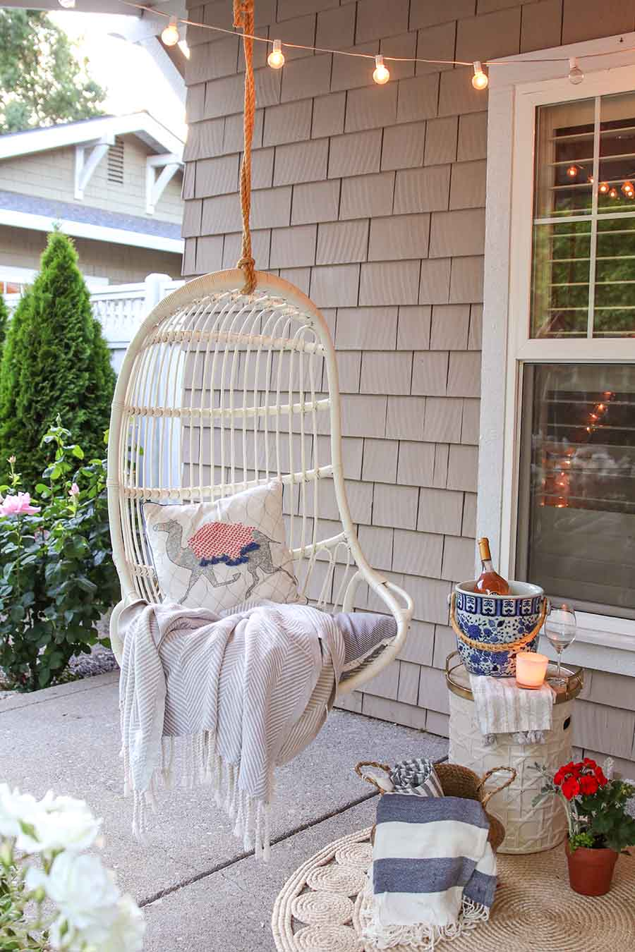 outdoor entertaining. front porch swing. summer front porch decor. summer front porch decorating