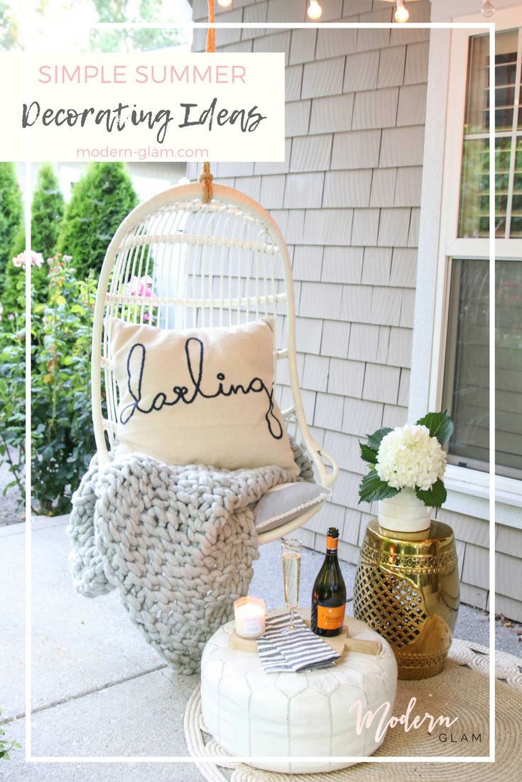 front porch swing with pillow and flowers