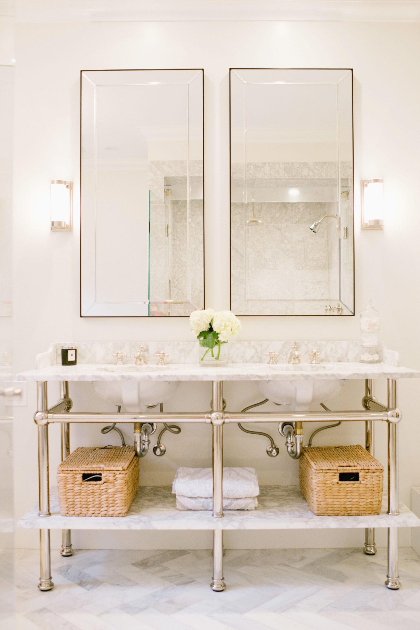 marble bathroom with apothecary sink