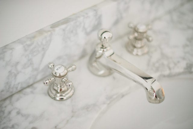 marble countertop with polished nickel fixture
