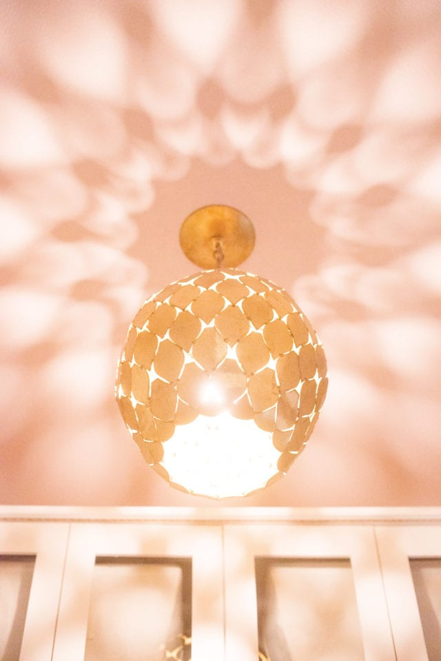 light fixture with pink ceiling