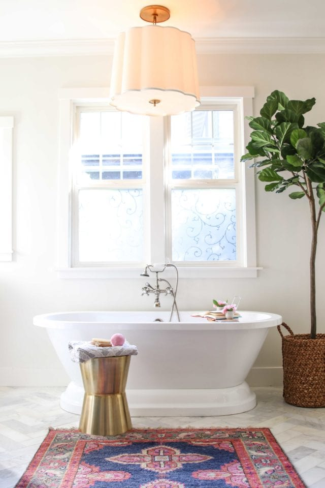 marble bathroom with herringbone tile