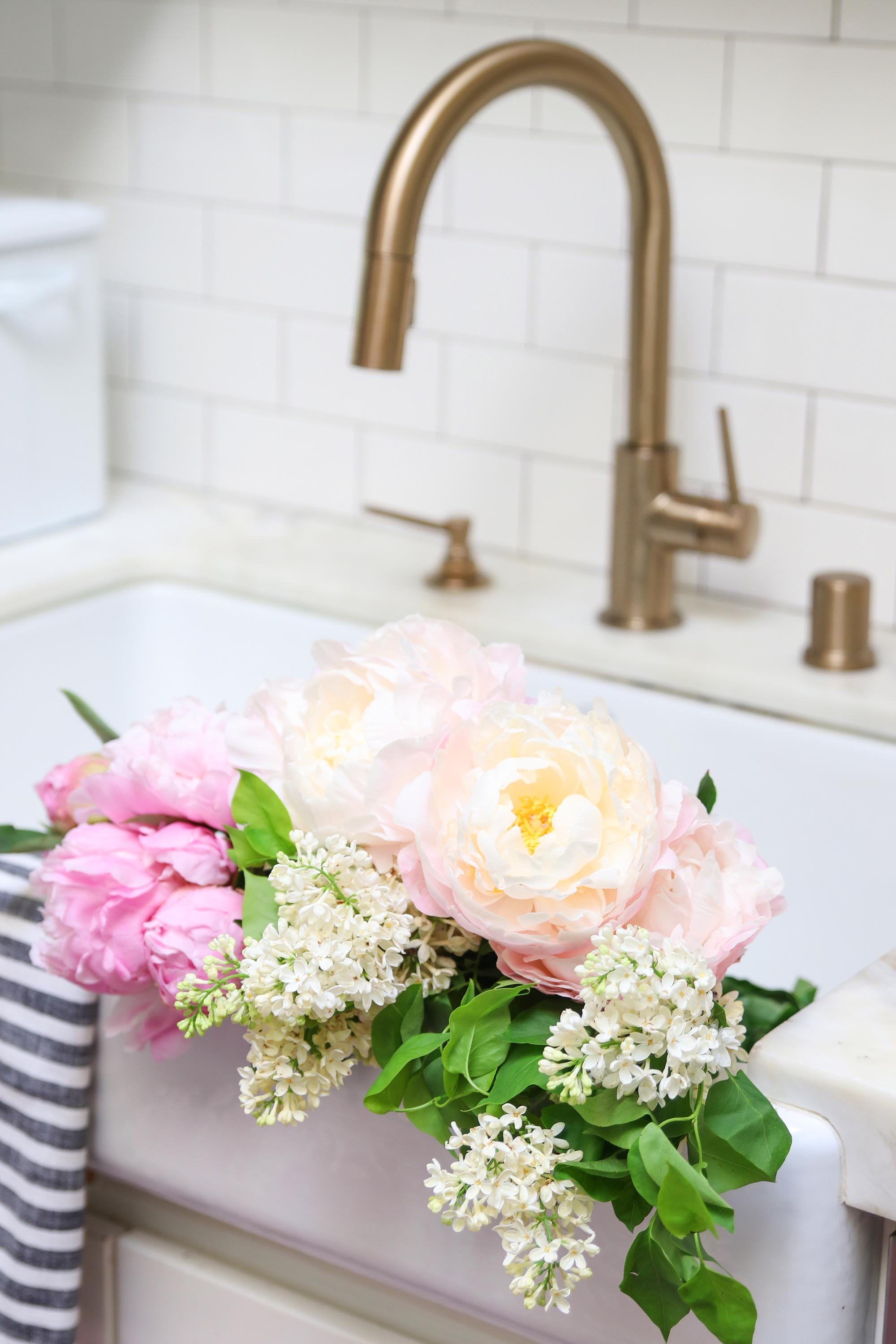 peonies in kitchen sink