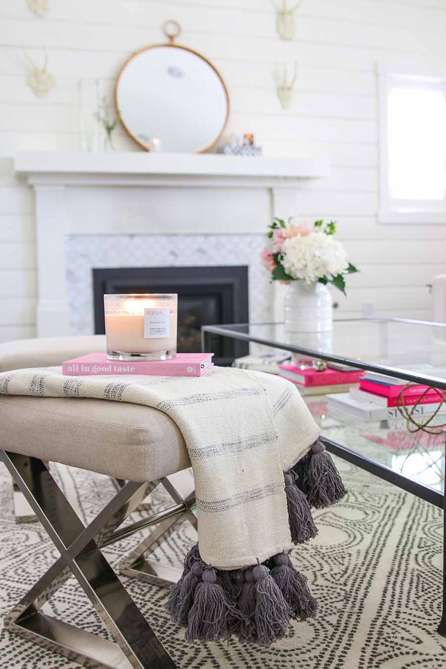 simple summer decorating ideas: throw with tassels styled with candle and book
