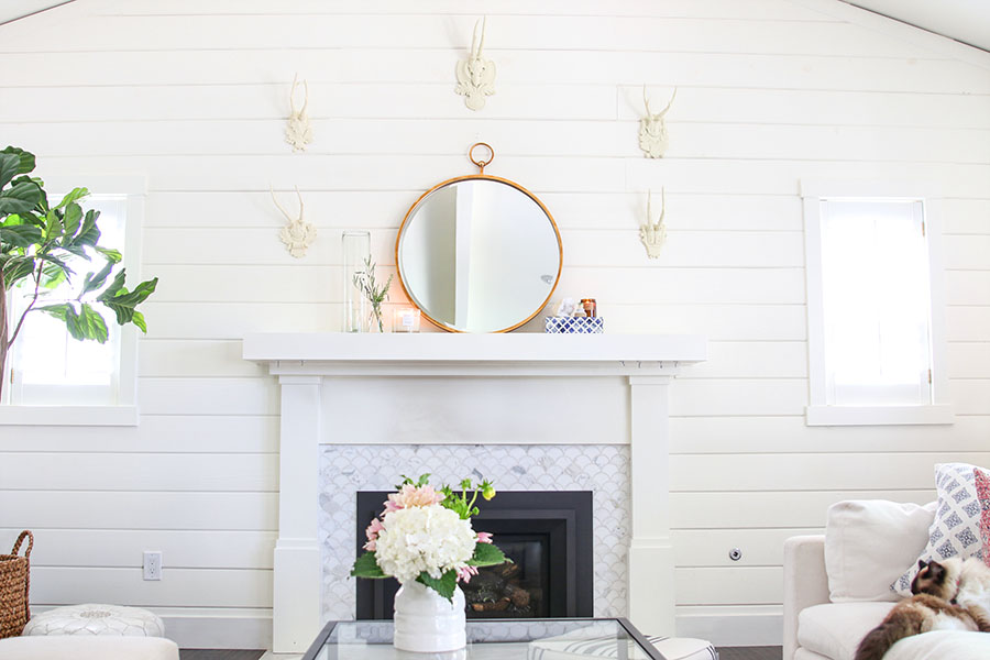 White shiplap wall with mantel and mirror