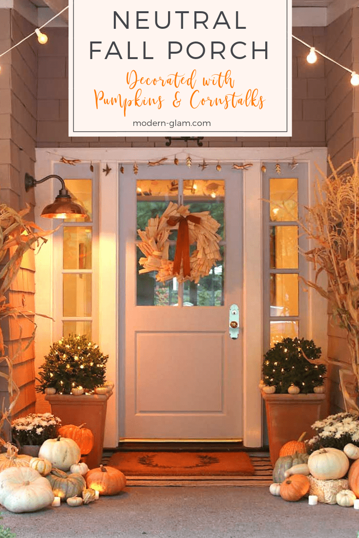 neutral fall porch decorated with pumpkins and cornstalks