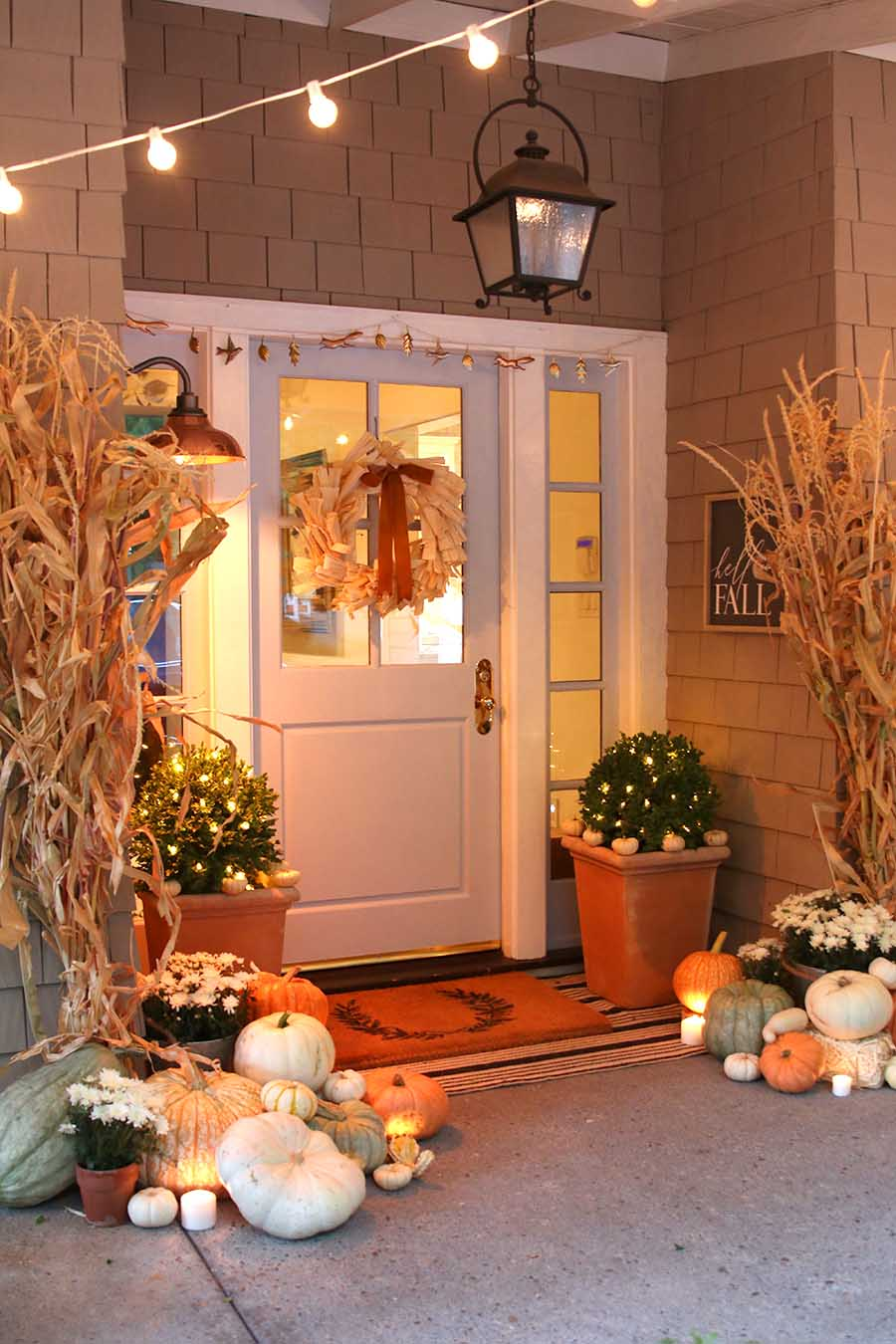 Neutral fall porch decor with pumpkins and cornstalks - Fall decorating ideas for front porch ...