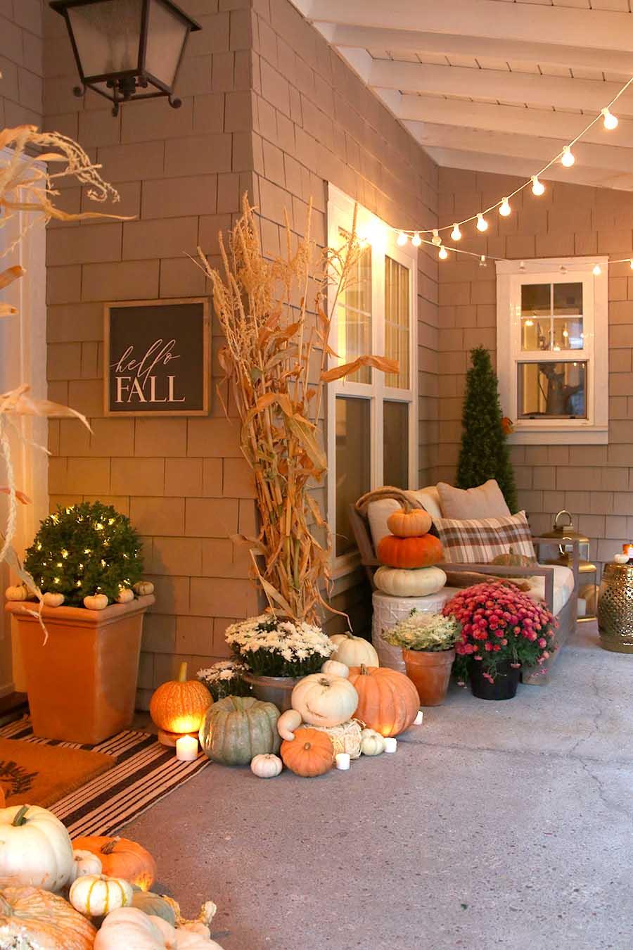 Neutral fall porch decor with pumpkins and cornstalks - Fall porch decorating ideas ...
