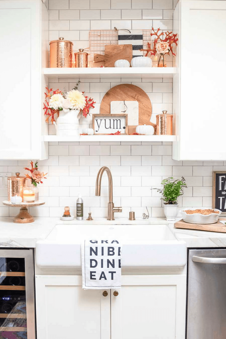 kitchen shelves with copper and breadboards