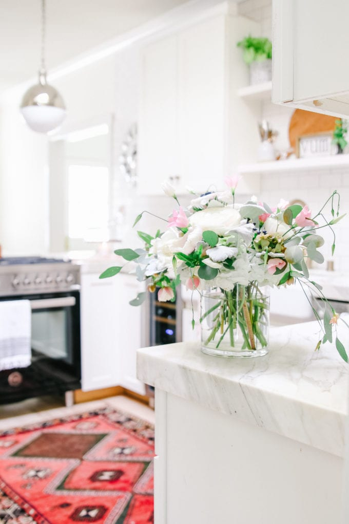 white kitchen with vintage rug