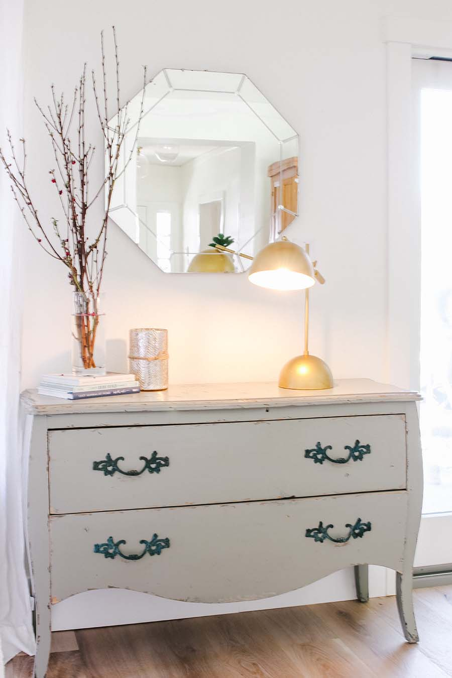 chest of drawers with mirror and lamp