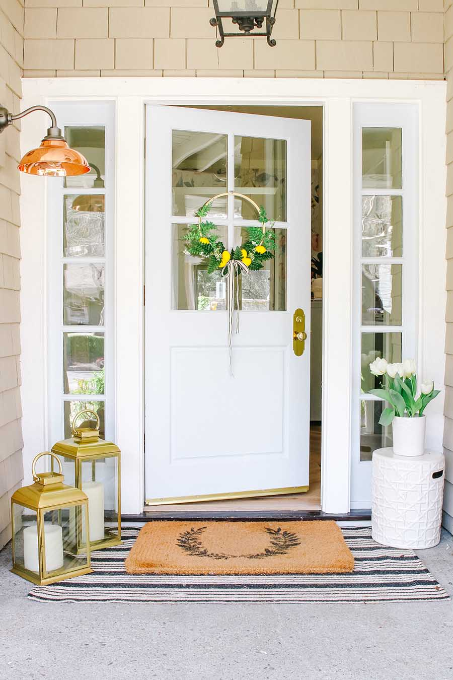 Front porch with blue door and lemon wreath