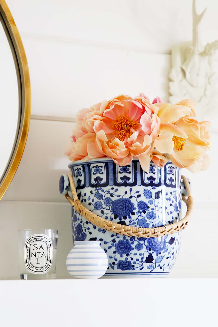 peonies in blue pot