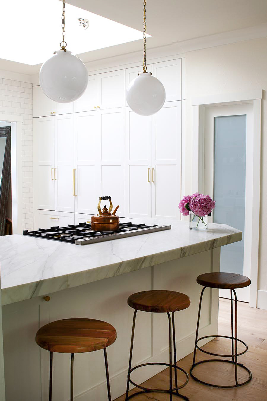 integrated appliances in white kitchen