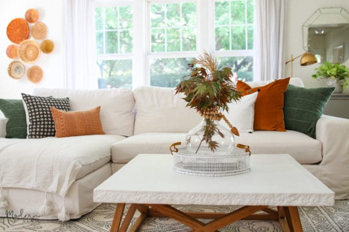 white room with rust accents