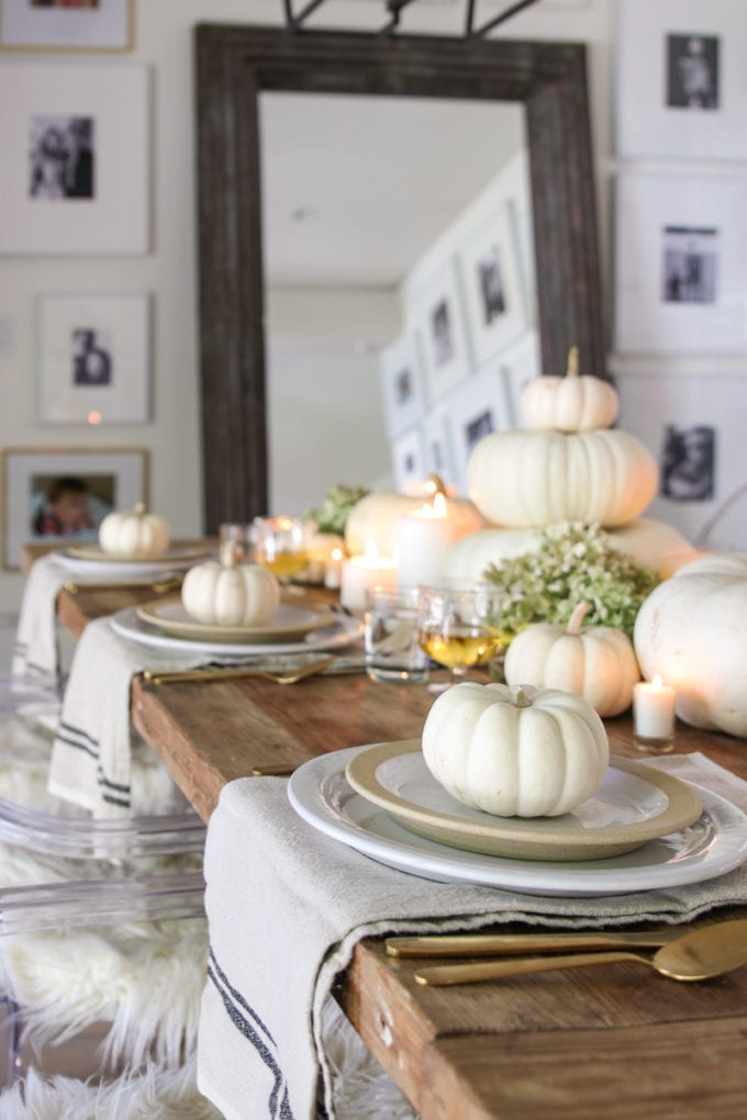 table with white pumpkins