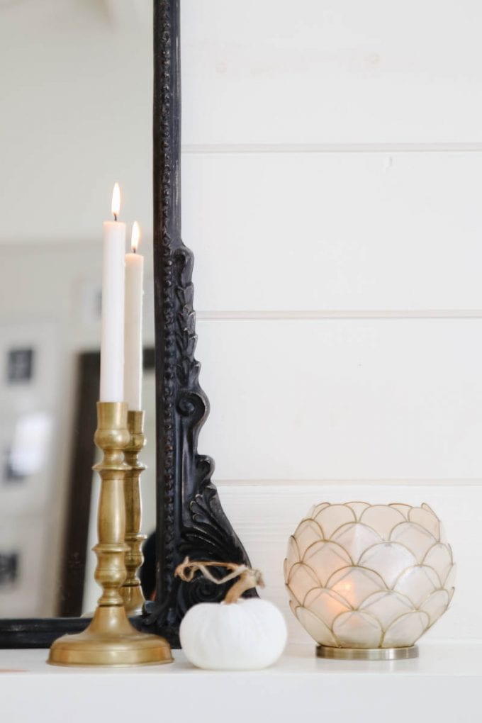brass candlesticks on mantel