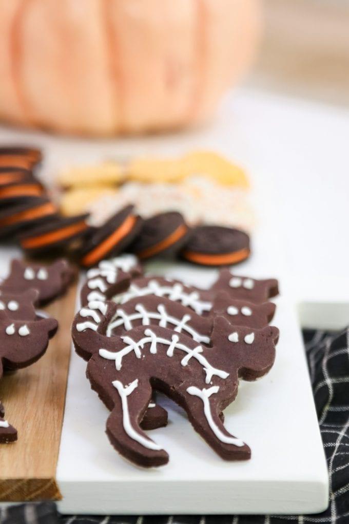black cat skeleton halloween cookies