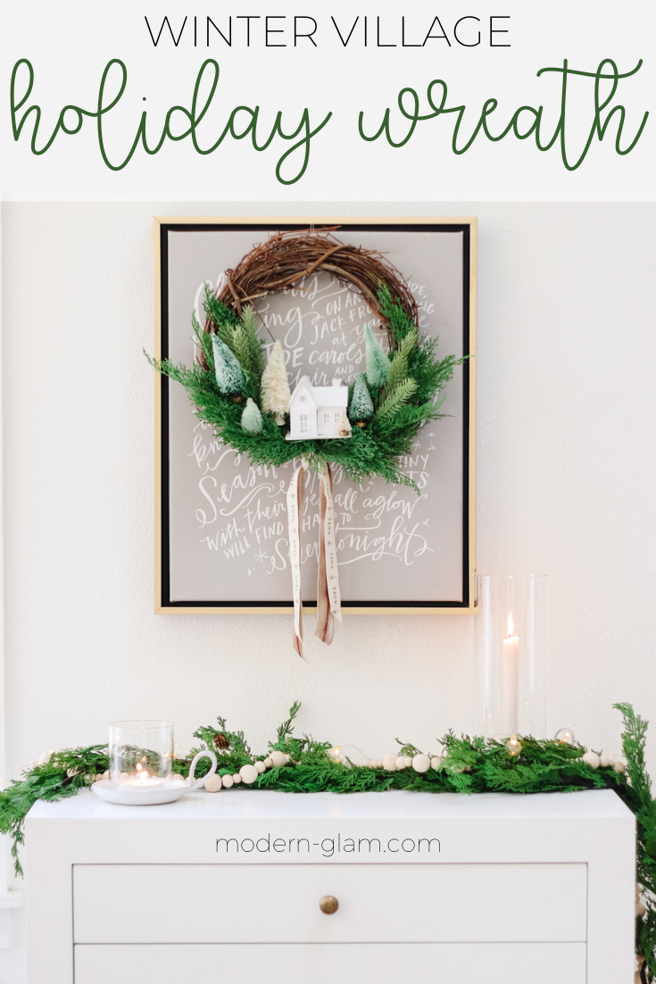 Make this fun and whimsical winter village wreath. Easy minimalist winter wreath with bottlebrush trees and a putz house. Diy Christmas wreath. via @modernglamhome
