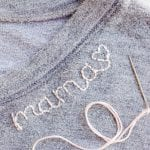 custom lettering stitched on shirt